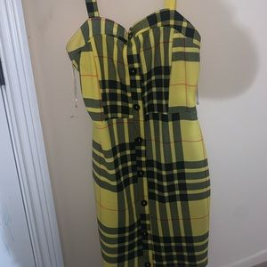 Plaid kind of stripped yellow and black dress.